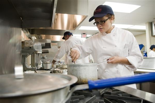 Student cooking in the CCM kitchen