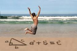 beach next to surf with equation written in sand and boy jumping in air